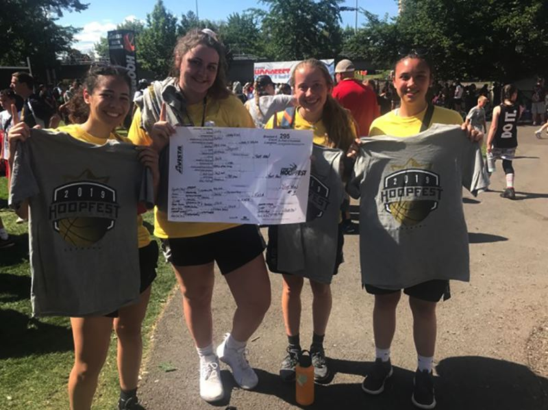 CONTRIBUTED PHOTO - Members of the Sandy-based team Yeet Haw display their championship T-shirts from the 3-on-3 HoopFest in Spokane.