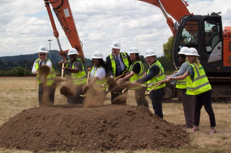 PMG PHOTO: STEPHANIE BASALYGA - Oregon Supreme Court Associate Justice Adrienne C. Nelson, second from left, participates in a groundbreaking marking the start of a project that will turn a middle school building in Happy Valley into a high school that will bear her name.