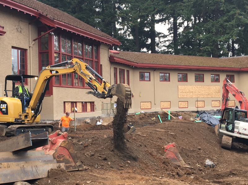 COURTESY PHOTO - Construction workers move earth during the renovation and repair of Peninsula Pool and the adjacent community center.