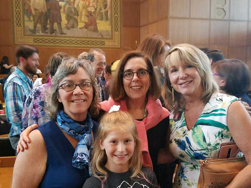 COURTESY PHOTO - Rep. Barbara Warner-Smith (D-District 45) and Gov. Kate Brown congratulated Darla Sturdy, right, and her granddaughter Maggie Zelinka on the passage of their bill to increase oversight on public transportation-related deaths.