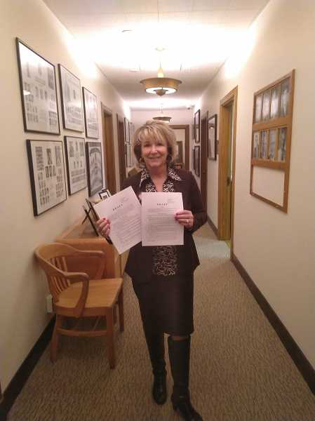 COURTESY PHOTO - Darla Sturdy posed with two bills she was working on at the start of the recent Oregon legislative session.