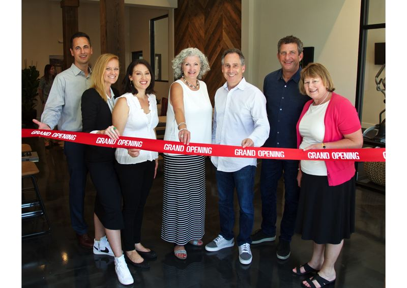 COURTESY PHOTO: CRAIG MITCHELLDYER  - Investors Management Group leaders at a Community Clubhouse preview event June 17 at Caldera at Sunnybrook Apartments include, from left, Dave Mikkelsen, Julie Flesner, Kris Gillum, Karlin Conklin, Marc Gordon, Neil Schimmel and Ann Blume.
