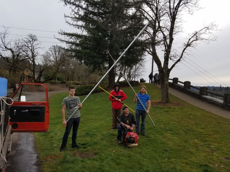 COURTESY PHOTO - Rivers of Life Center youth workforce members pose with long-handled rakes that were designed to help establish the wildflowers behind the wall of the McLoughlin Promenade in Oregon City.