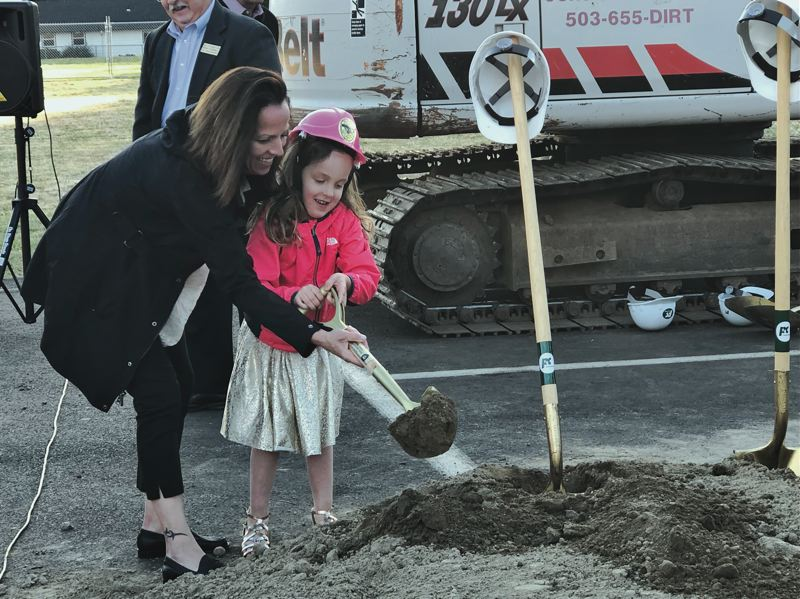 PMG PHOTO: STEPHANIE BASALYGA - Ziva Libke, Robert Libke's daughter, and her mom, Wendy Libke, participate in a groundbreaking ceremony held in June to kick off the start of work by Lease Crutcher Lewis on the new public safety building that will be named in honor of Robert.