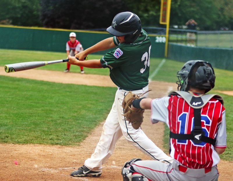 PMG PHOTO: DAN BROOD - Tigard Little League's Lusiano Lopez takes a swing during the team's District 4 Majors tournament semifinal contest with Raleigh Hills.