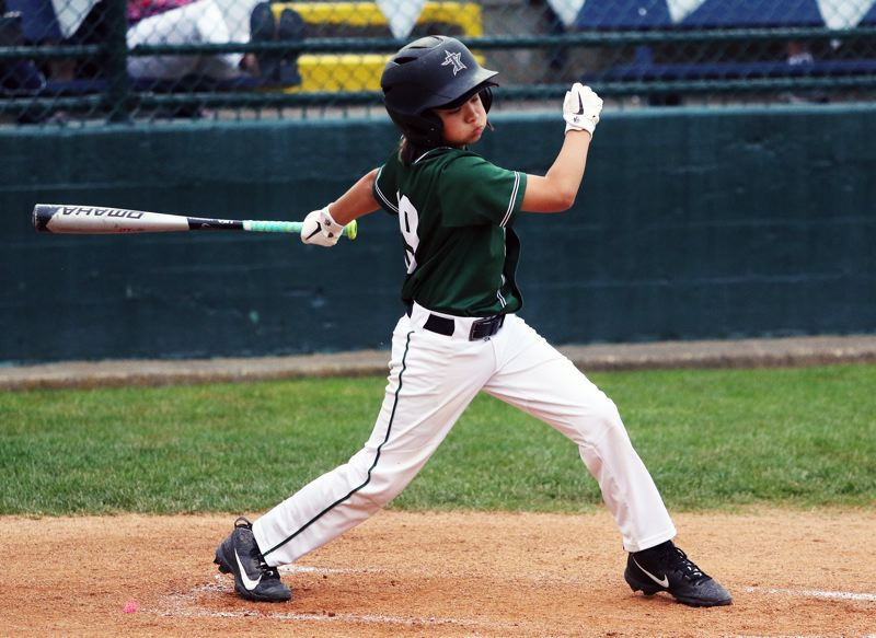 PMG PHOTO: DAN BROOD - Tigard's Ollie Jones takes a swing during action at the District 4 Little League Majors tournament semifinal game against Raleigh Hills.