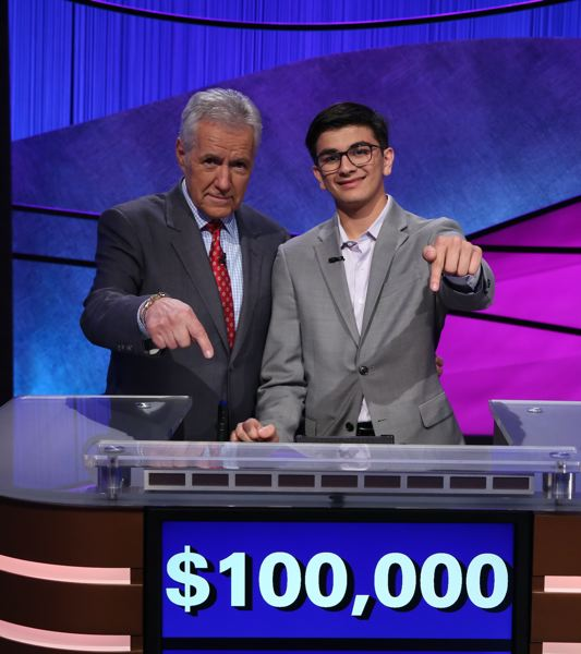 COURTESY: 'JEOPDARY!' - Portland student Avi Gupta (right, standing with host Alex Trebek) was the big winner on the 'Jeopardy!' Teen Tournament. He says he'll use some of his winnings — $100,000 — to further his activist interests, such as helping support pancreatic cancer research. Trebek, who Gupta admires greatly, suffers from pancreatic cancer.