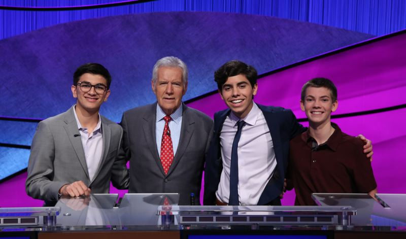 COURTESY: 'JEOPARDY!' - Avi Gupta (left) stands with 'Jeopardy!' host Alex Trebek and fellow Teen Tournament contestants Lucas Miner and Ryan Presler.