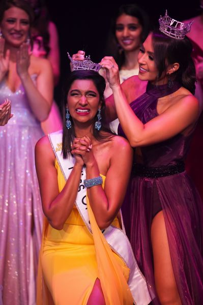 COURTESY: BEN WOOD PHOTOGRAPHY - Shivali Kadam receives the Miss Oregon crown from 2018 winner Taylor Ballard. It was Kadam's fourth try at becoming Miss Oregon. 'The fact that I was selected on my last chance was incredible,' Kadam says.