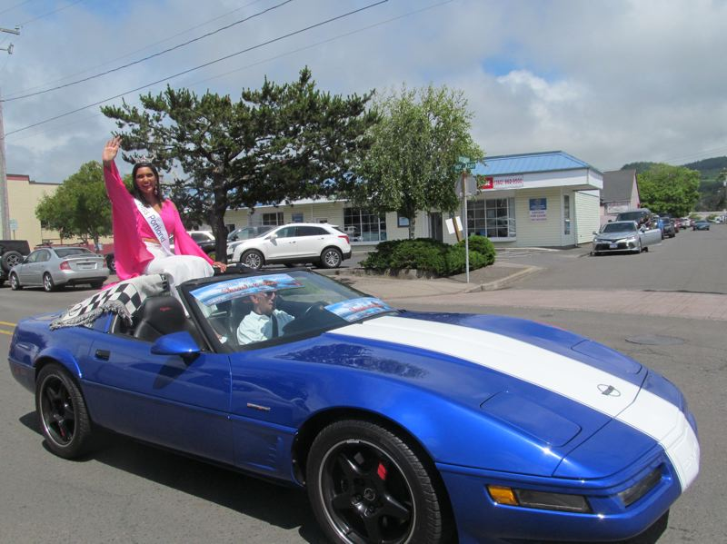 PMG PHOTO: ELLEN SPITALERI - Shivali Kadam, 2019 Miss Oregon, rides high in a Corvette in a post-pageant parade in Seaside. She wants to use her status to promote female engineers.