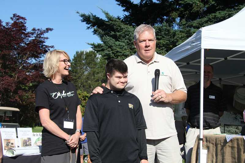 PMG PHOTO: SAM STITES - Beth Hoover (left) stands with Grant and Marc Naffziger as they explain the impact the Mobility Impaired Golf Association has had on Grants life.