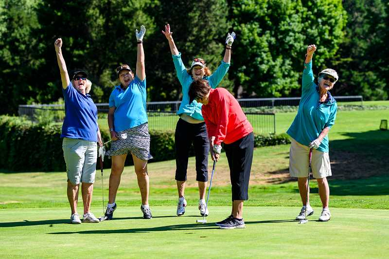 COURTESY PHOTO: EVERGREEN EVENT PHOTOGRAPHY - An all-ladies fivesome celebrates a sunken putt on the tenth green during the 2019 Oliphant