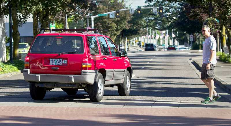 PMG FILE PHOTO - Pedestrian safety will be a focus of a targeted enforcement effort on tap by the Newberg-Dundee Police Department.