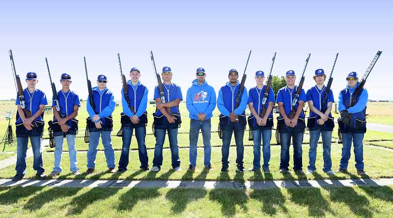SUBMITTED PHOTO - Left to right, Mason Lee, James Lange, Seth Feigner, Connor Comingore, Seth Colton, coach Kevin Tollefson, Nico Navarro, Logan Lee, Carson King, Justin Borchert and Elias Tollefson were all part of the Madras High School trap shoot team this year. Eight of the shooters won the trap shooting state title in Hillsboro June 28.