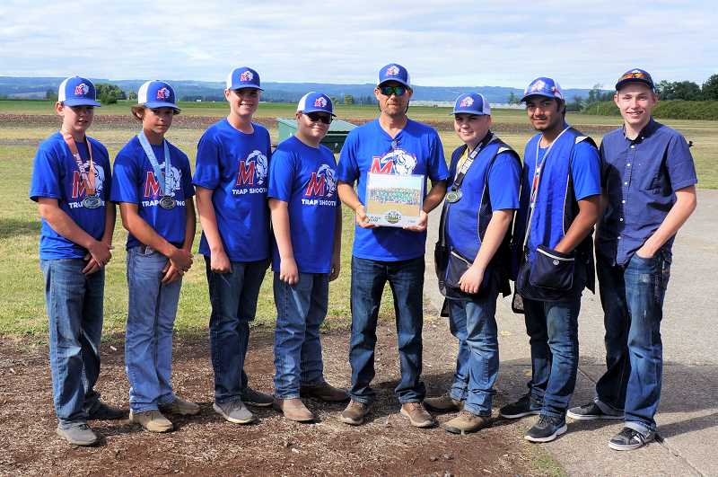 SUBMITTED PHOTO - Left to right, Mason Lee, James Lange, Logan Lee, Seth Feigner, coach Kevin Tollefson, Elias Tollefson, Nico Navarro, Connor Comingore, and not pictured, Justin Borchert, win the state championship trap shoot compeition.