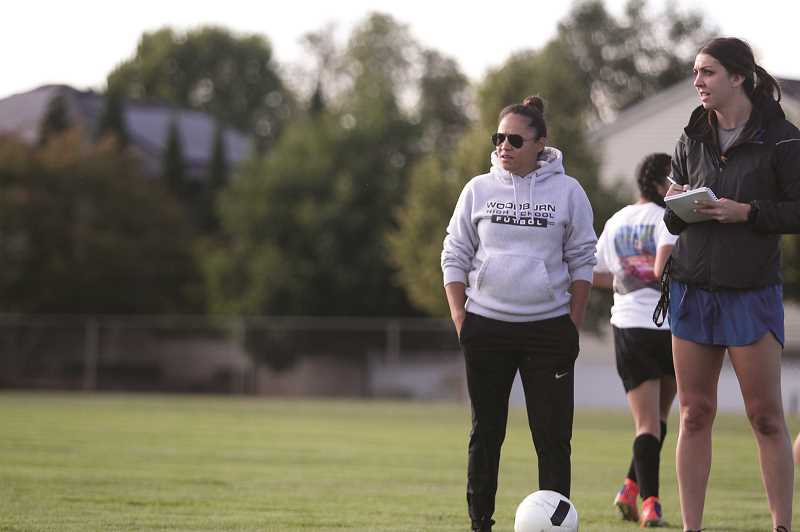 PMG PHOTO: PHIL HAWKINS - Vazquez has been a member of the Woodburn High School girls soccer coaching staff for three years, working with head coach Andrea Whiteman (far right) to prepare the incoming junior varisty players for the rigors and expectations of varsity soccer.