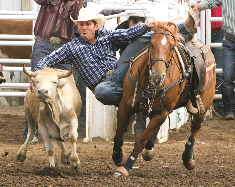 COURTESY PHOTO: HOOT CREEK - Riley Duvall, Checotah, Okla., split the steer wrestling win at the 2019 St. Paul Rodeo with fellow Oklahoman Blake Mindemann. Both cowboys had times of 8.8 seconds on two head.