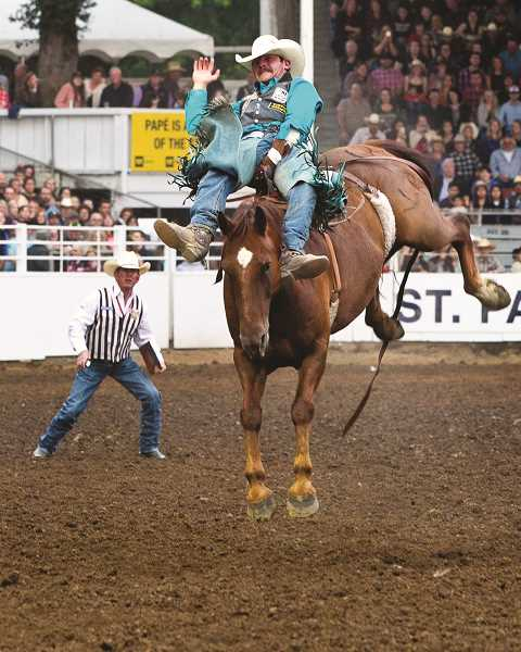 COURTESY PHOTO: HOOT CREEK - Trenten Moreno scored 87 points to win the bareback riding title at the St. Paul Rodeo.