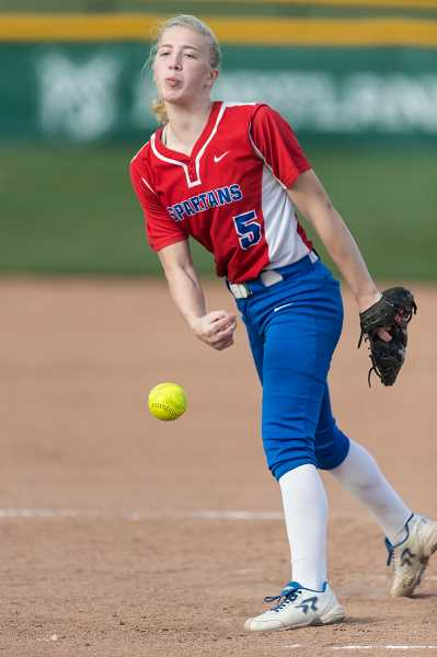 PMG PHOTO: CHRISTOPHER OERTELL - Hillsboro High School's McKenzie Staub throws a pitch during a game against Liberty early last season. Staub shared the NWOC Pitcher of the Year award and was a first team all-state selection.