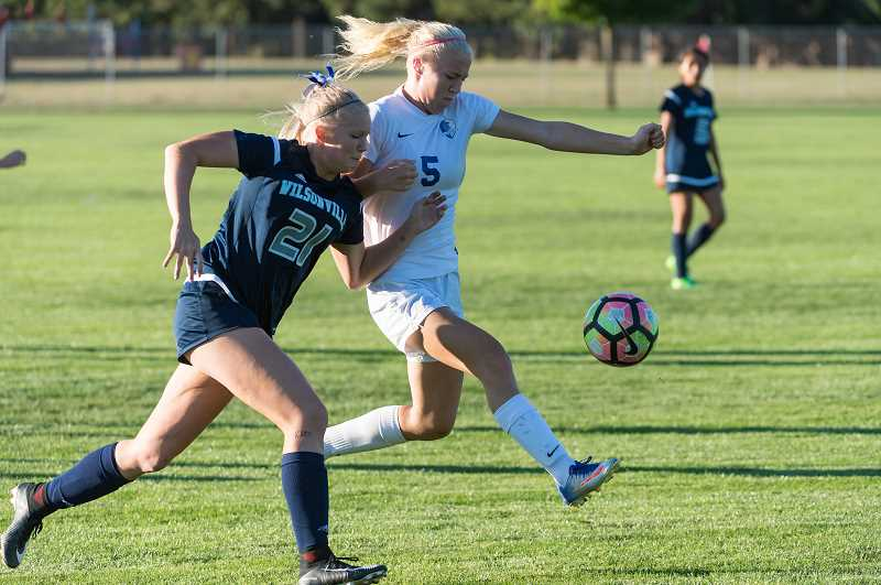 PMG PHOTO: CHRISTOPHER OERTELL - Hillsboro's McKenzie Staub battles a Wilsonville defender on the pitch. Staub was a second team All-NWOC selection last year for the Spartans.