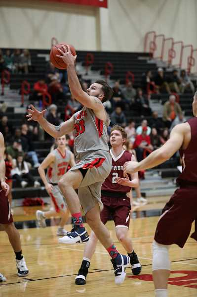 COURTESY PHOTO: ELLIE PARKER - Pacific University's Gage Shelmidine goes up for a lay-in during a Boxers game last season. Shelmidine was the team's third leading scorer, averaging 13.4 points per game.