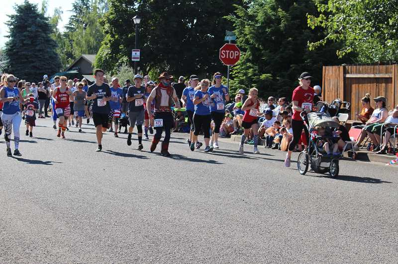 PMG PHOTO: SANDY STOREY - From kids to adults, 648 people participated in the Freekom 5k in Molalla on July 4.