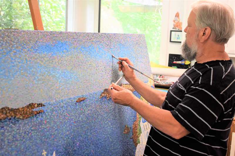 PMG PHOTO: EMILY LINDSTRAND - John Freese completes oil paintings in a pointillism style, in which small dots are applied to the canvas in patterns.