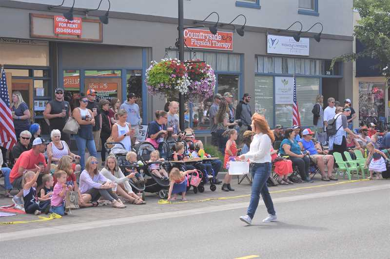PMG PHOTO: EMILY LINDSTRAND - State Rep. Christine Drazan hands out candy during the Fourth of July parade last Thursday.