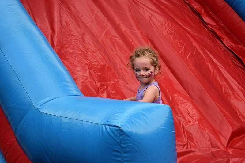 PMG PHOTO: EMILY LINDSTRAND - A young attendee of DJ Jonny Blaze's third annual River Fest enjoys the bounce house.