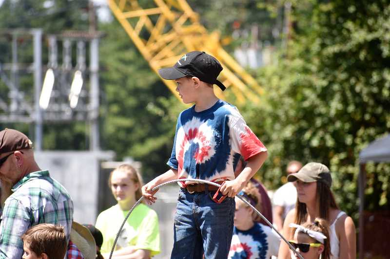 PMG PHOTO: EMILY LINDSTRAND - A young attendee of the Estacada Timber Festival is eager to participate in the youth choker competition.