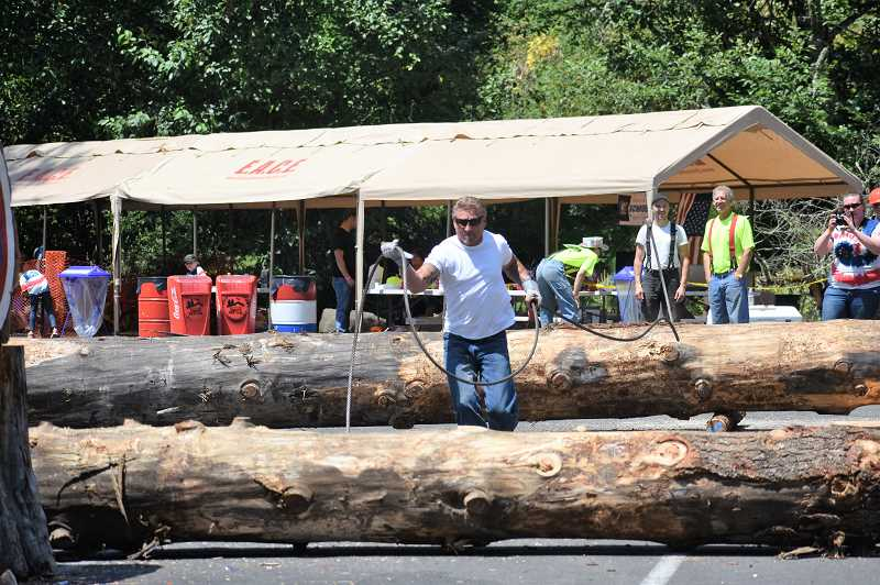 PMG PHOTO: EMILY LINDSTRAND - An attendee of the Estacada Timber Festival participates in the  choker competition.