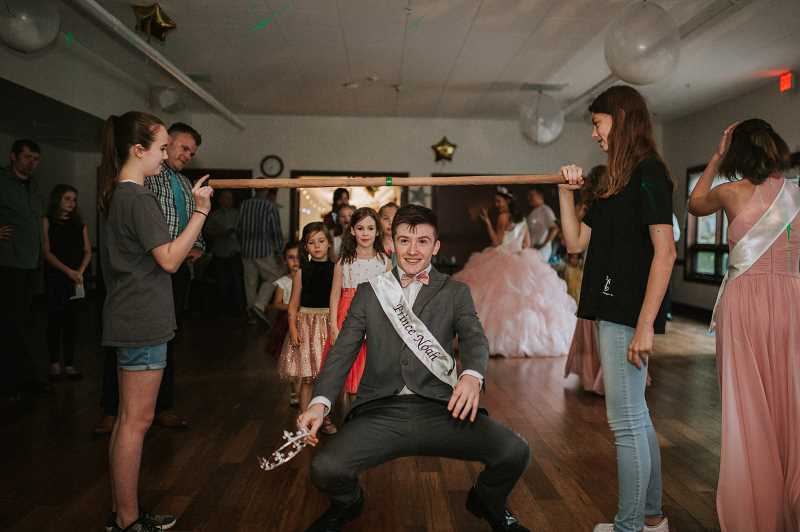 COURTESY PHOTO - Noah Eddy joins the fun at the Daddy and Daughter dance at the Adult Community Center.