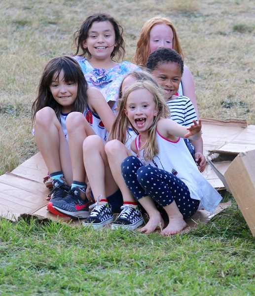 PMG PHOTO: BRIAN MONIHAN - A large portion of the hill at Willamette Park became the official cardboard sliding zone for numerous kids and some daring adults.