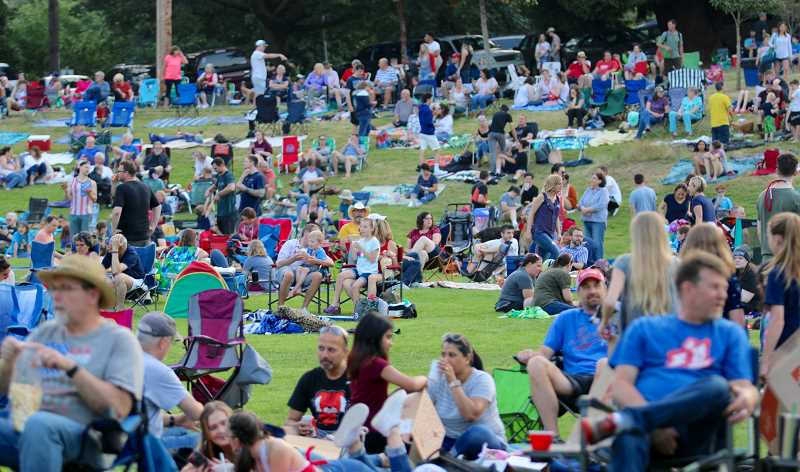 PMG PHOTO: BRIAN MONIHAN - By 7:30 p.m. Willamette Park was filling up quickly in anticipation of the fireworks show that started at dusk.
