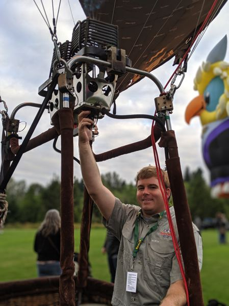 PMG PHOTO: COURTNEY VAUGHN - David Dunrud fires up 'Rocket the Flying Squirrel,' a hot air balloon he piloted at the Festival of Balloons.