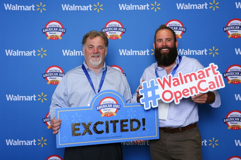 COURTESY PHOTO: WALMART - Oregon City-based 503 Distilling co-founders, CEO Dave Schleef and COO Rusty Caldwell, celebrate Walmart announcing they will distribute their company's vodka and canned cocktails to more than 400 stores.