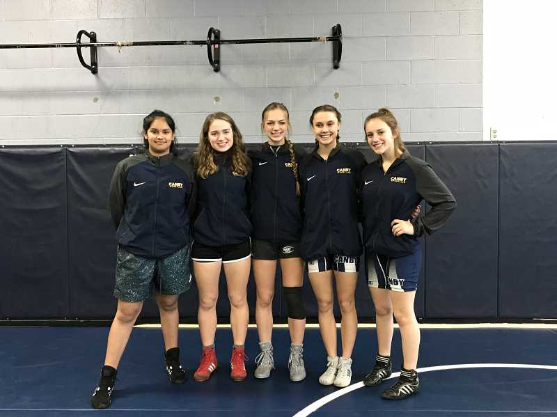 COURTESY PHOTO: MAREN GINGERICH - Maren Gingerich, second from left in the red shoes, worked to encourage other women to join the wrestling team.