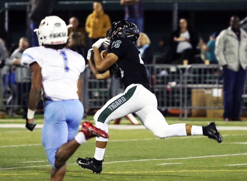 PMG PHOTO: DAN BROOD - Jazz Ross was a key player for both the Tigard High School football and boys basketball teams this past year as a Tiger senior.
