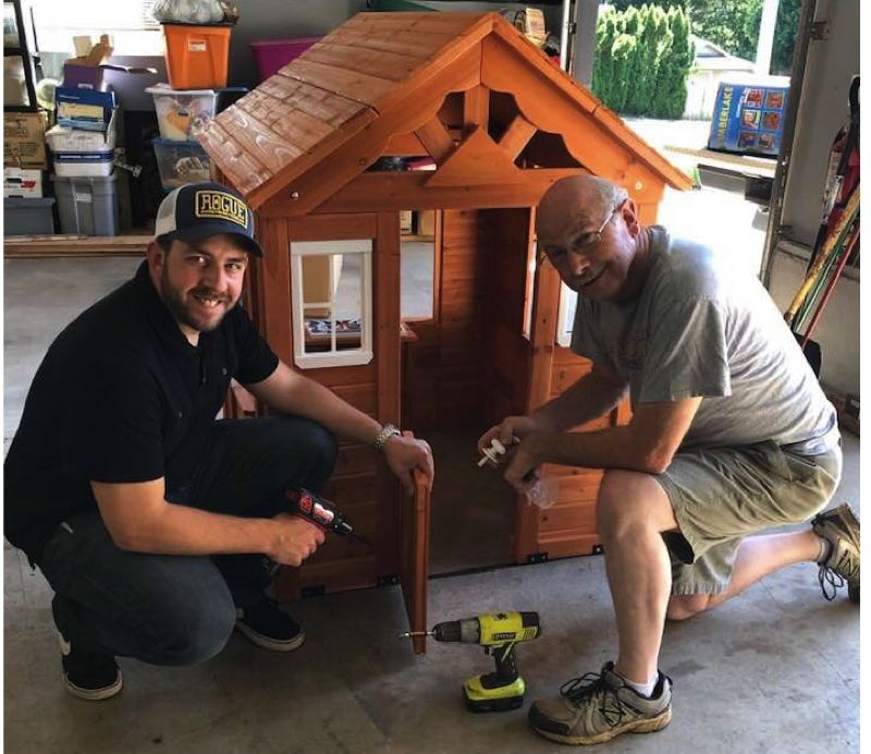 COURTESY PHOTO - Grant Baker and Carl Exner built a playhouse not only to fit the theme of Windermere's parade float, but as incentive for others to give back.