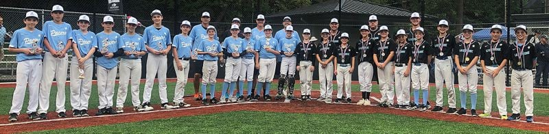 COURTESY PHOTO - The Lakeridge 12U (left) and Lakeridge 11U teams pose with their medals after the 12U team beat the 11U team 3-2 in the championship of the 12U Firecracker Classic at Walga Park _ East on Sunday, July 7.