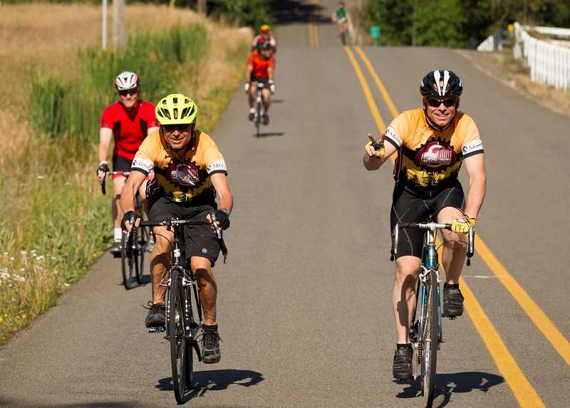 PMG PHOTO/JAIME VALDEZ - Bicyclists make their way up SW Homesteader Road during Wilsonvilles second annual Salmon Cycling Classic bicycling event.