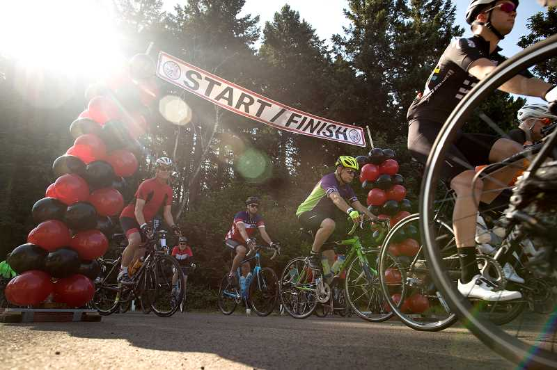 PMG PHOTO/JAIME VALDEZ - Bicyclists begin riding in Wilsonvilles second annual Salmon Cycling Classic bicycling event at Memorial Park.