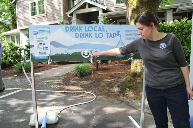 PMG PHOTO: SAM STITES - Assistant Public Works Director Rachel Sykes demonstrates a new water tap project at an event earlier this year. Sykes led the initiative to implement smart meters for the City's water customers.