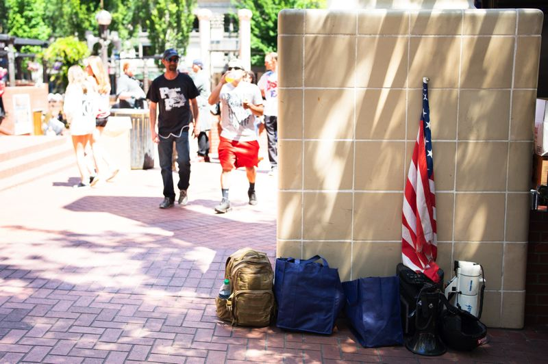 PMG PHOTO: KIT MACAVOY - A man wearing a Patriot Prayer shirt approaches supplies used by right-wing protesters during a demonstration downtown on June 29.