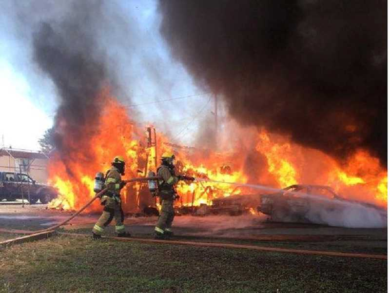 SUBMITTED PHOTO - Jefferson County Fire District firefighters respond to a fire at Tops Trailer Park July 7. Cause of the fire, which burned two trailers and four parked vehicles, has not been determined.