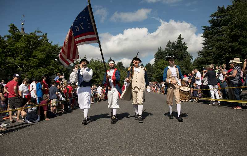 PMG PHOTO: JAIME VALDEZ - Men dressed in period clothing march down A Avenue during the Star Spangled Parade.