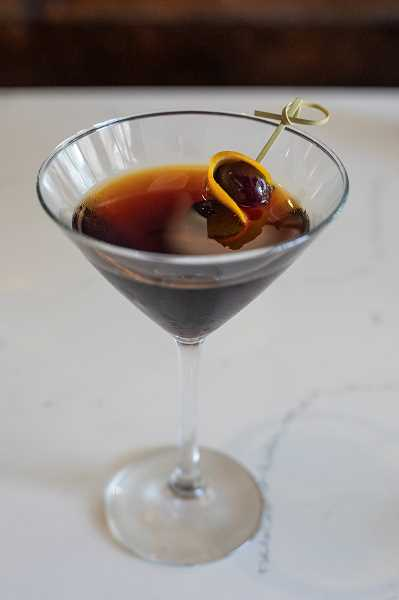 PMG PHOTO: JONATHAN HOUSE - A Black Manhattan at Filberts Farmhouse Kitchen.