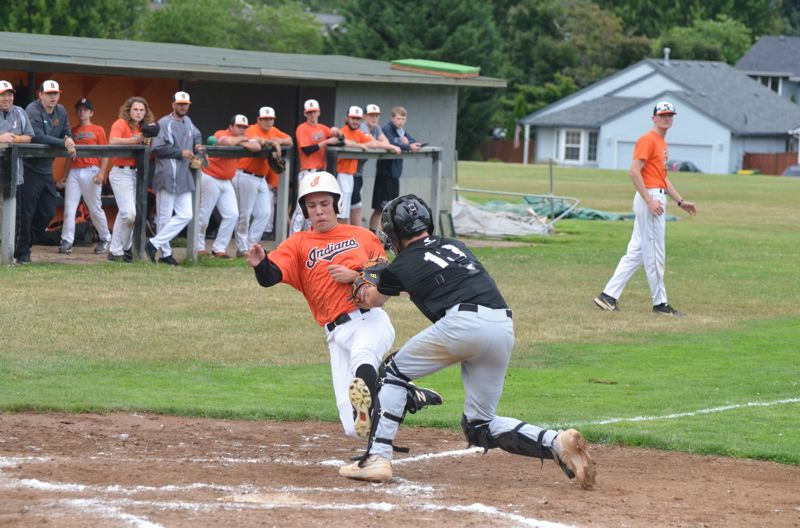 COURTESY PHOTO: JOHN BREWINGTON - Tyler Souvenir of Scappoose gets tagged out at home trying to score from second base on an Andrew Darco single in a Wednesday home game against Hillsboro-Forest Grove.
