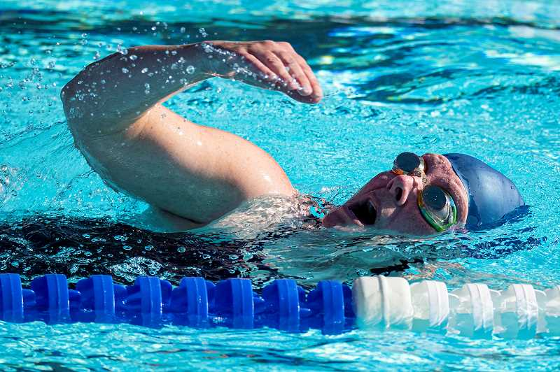 LON AUSTIN/CENTRAL OREGONIAN - Rachel Wendt-Chaney swims the opening leg of the Splash N' Dash on Thursday, July 4. More than 160 athletes competed in this year's event, which included a quadrathlon, triathlon, biathlon and 5K run.