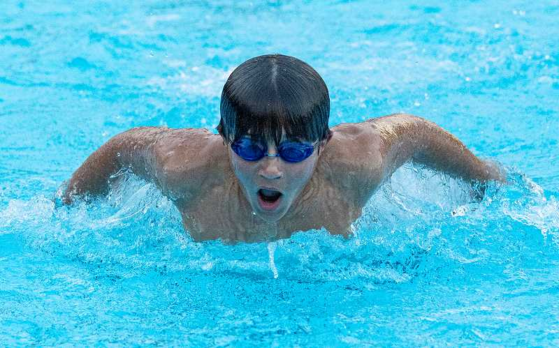 LON AUSTIN/CENTRAL OREGONIAN - Nathan DelaPena swims the butterfly during a recent practice. DelaPena placed in five events at the Jay Rowan Open this past weekend, including a fifth-place finish in the 100 butterfly.